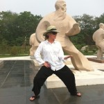 Troyce posing like one of the statues at the Chen Museum